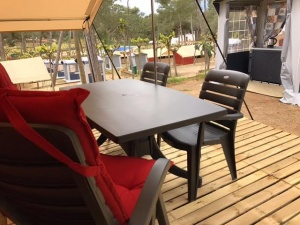 The Safari tent has a wooden porch on which you can smoothly relax under the canopy.